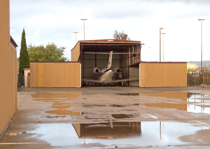 Puddles at the Port-A-Port hangars, Oakland North Field, KOAK, California